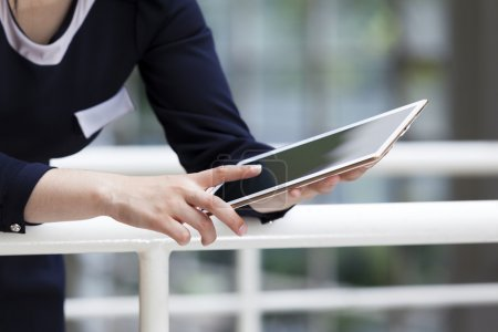 businesswoman working with digital tablet