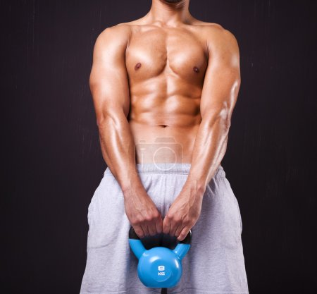 Fitness man lifing a dumbbell