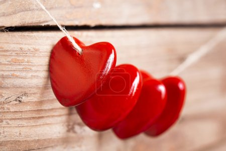 Valentine's hearts on rustic wooden background