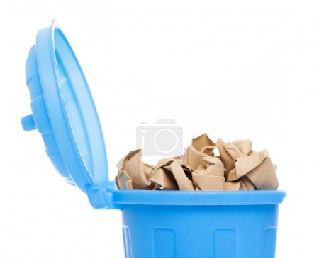 A blue bin full of crumpled paper