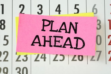 The phrase Plan Ahead written on sticky paper