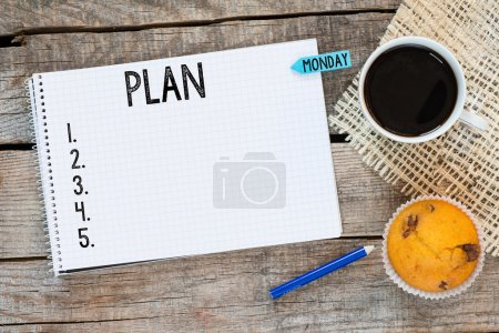 Photo for Notebook with an action plan and sticker monday on wooden desk with cup of coffee and muffin - Royalty Free Image