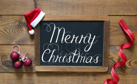 Merry Christmas inscription on chalk blackboard