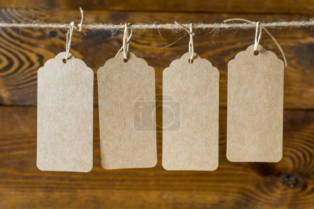 Price tags on wooden plank background
