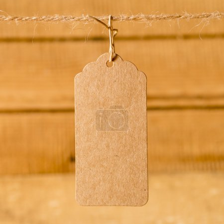 Price tag on wooden plank background