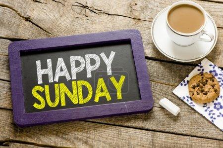 Happy sunday on blackboard