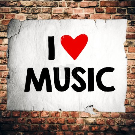 Photo for Grunge paper with I love music on  brick wall background - Royalty Free Image