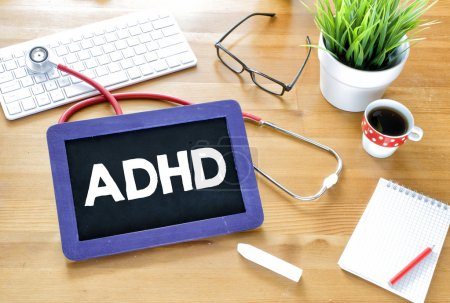Handwritten ADHD on blackboard
