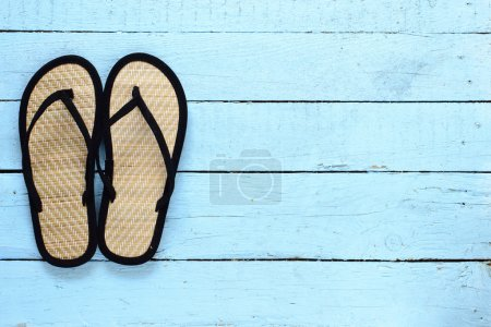 Flip-flops on  wooden background