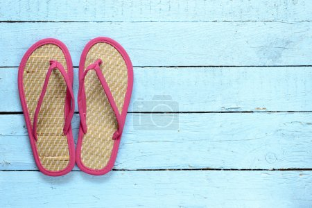 Flip-flops on  wooden background