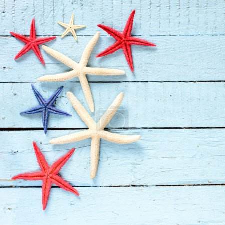 Starfish on wooden background