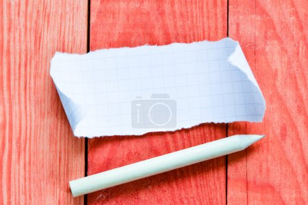 Photo for Pencil and torn paper sheet on wooden table - Royalty Free Image