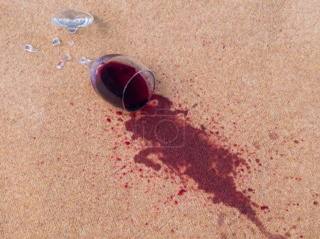 Photo for Glass of red wine dropped on the carpet - Royalty Free Image