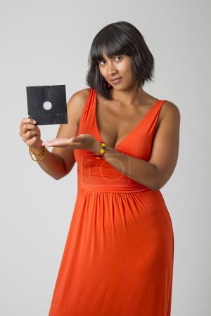 Sexy asian woman wearing a low cut orange dress, h...