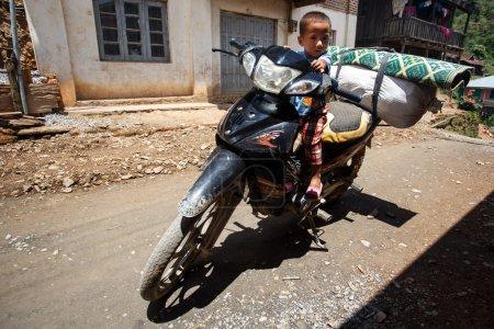 Boy Riding Motorbike in Falam, Myanmar