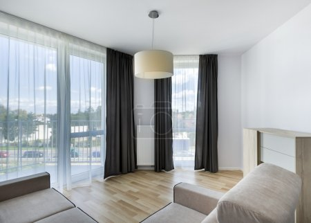 Big windows in modern living room apartment