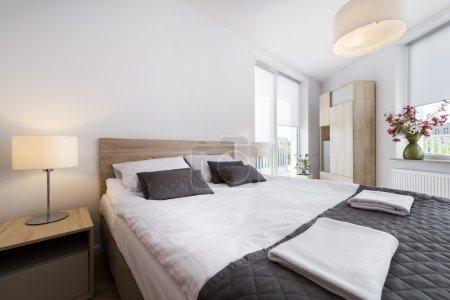 Photo for Modern and comfortable bedroom interior design in scandinavian style - Royalty Free Image
