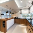 Modern kitchen interior design in black and white ...