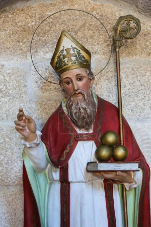Photo for Statue of Saint Nicholas of Bari in the church of San Francisco in the historic town Betanzos, Galicia, Spain. Saint Nicholas is holding three balls of gold, that represent the legend of the dowry. - Royalty Free Image