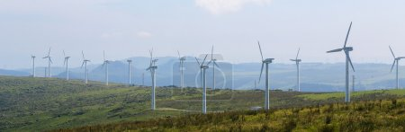 Photo for ORTIGUEIRA, SPAIN - JULY 23, 2014: Panorama of a wind turbine farm in the Northern part of Galicia, Spain. - Royalty Free Image