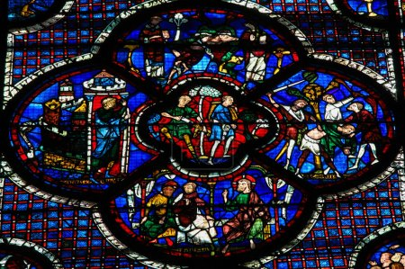 Photo for Stained Glass window in the Cathedral of Our Lady of Chartres, France, depicting various Bible Scenes - Royalty Free Image