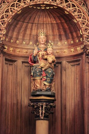 Photo for CHARTRES, FRANCE - JULY 21, 2015:  Notre Dame du Pilier or Our Lady of the Pillar Statue (16th Century), a polychrome statue in Cathedral of Our Lady of Chartres, France. - Royalty Free Image
