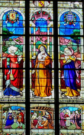 Photo for MORTAGNE-AU-PERCHE, FRANCE - JULY 20, 2015: Stained Glass depicting the Countesses of Perche, Mahaut de Buviere, Marie d'Armagnac and Marguerite de Lorraine, in the Notre Dame church of Mortagne, Perche, France - Royalty Free Image