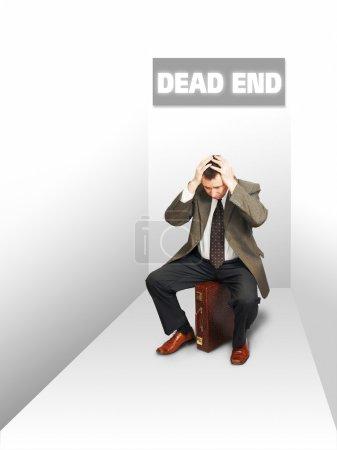 Desperate businessman in a deadlock. Concept of failure