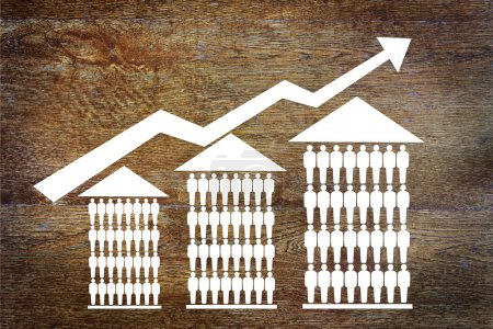 Growth sales of houses. Abstract image with paper scrapbooking