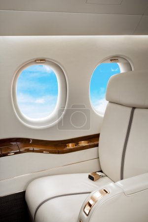 Aircraft (jet) porthole with clouds view