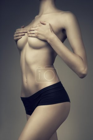 healthy girl with hands on breasts