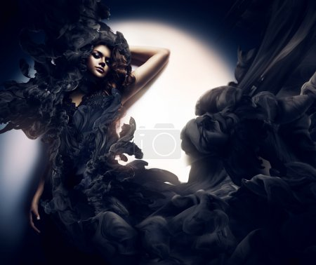 Photo for Attractive woman in black smoke - Royalty Free Image
