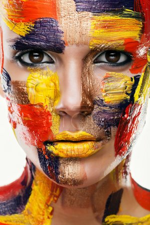 Photo for Close up portrait of woman in colourful paint - Royalty Free Image