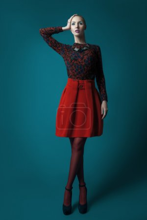 Elegant woman in red skirt