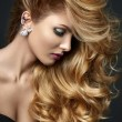 Woman with amazing hair on gray background...