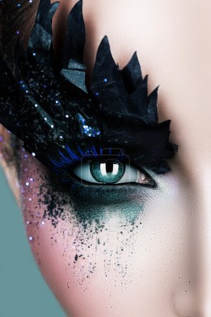 Woman with black paper make-up