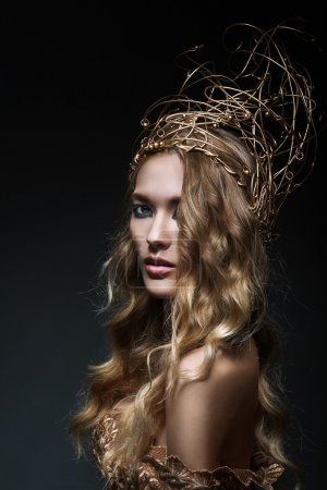 Curly blonde in gold crown