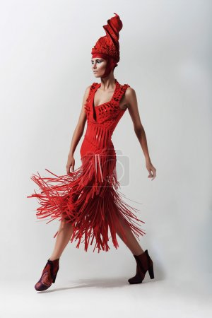 Photo for Pretty woman in swirl red hat and dress - Royalty Free Image