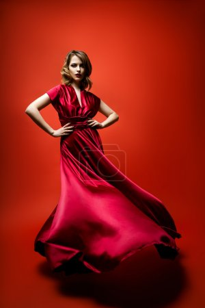 Woman in a flowing red dress