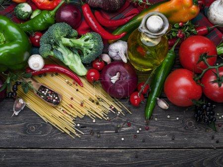 Photo for Italian food ingredients: pasta, tomatoes, mushrooms, herbs, vegetables, nuts  and spices on wooden background - Royalty Free Image