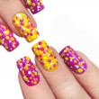 Multicolored manicure with dots of different shape...