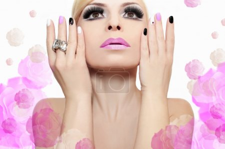 Fashion makeup and manicure .