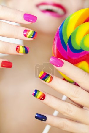 Rainbow manicure on artificial nails.