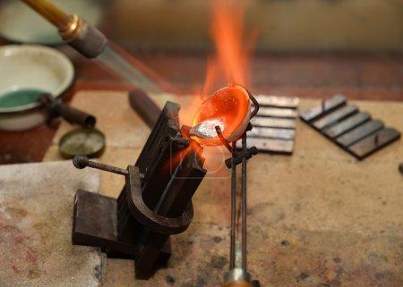 Jeweler melts precious metal