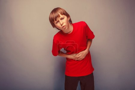 Boy teenager twelve years in the red shirt abdominal pain, gastr