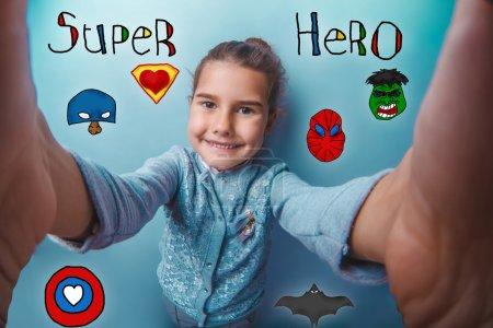 baby girl holding photo camera closeup Selfe super hero super po