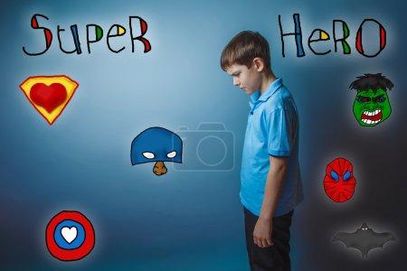 Teen boy bowed his head turned sideways and looking down superhe