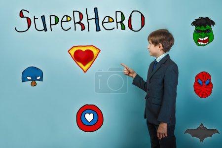 Teen boy businessman points finger stands sideways superhero sup