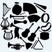 Different music instruments Isolated on blue background Vector silhouettes