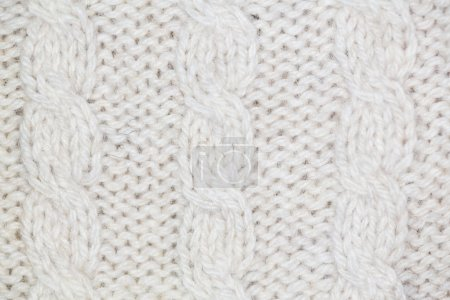 Knitting pattern from gray woolen warm soft yarn for background